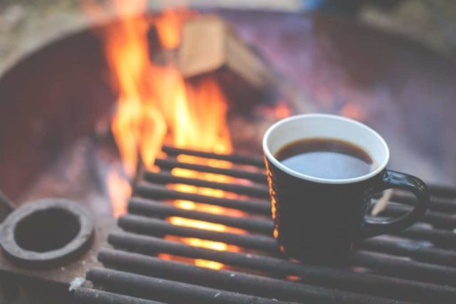 Coffee by the camp fire