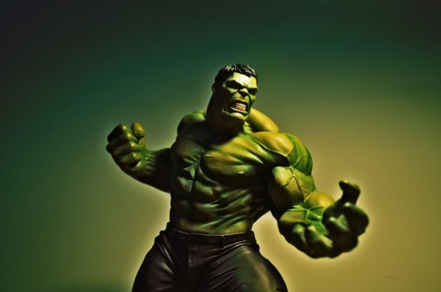 Hulk turning green and angry in front of green sky