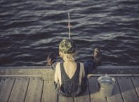 How_to_fishing_for_beginners_featured boy fishing on dock